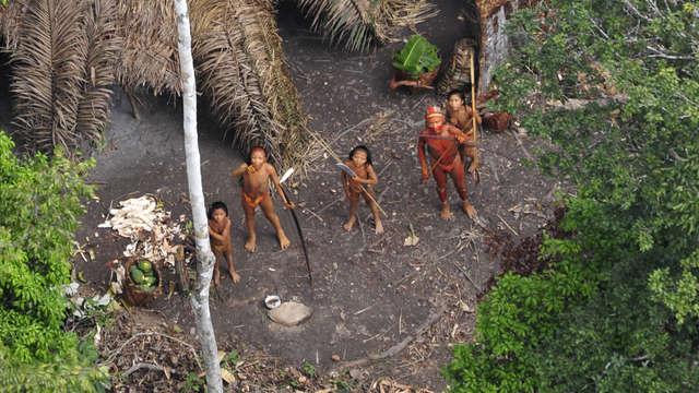 photograph of native people in village in brazil from the air